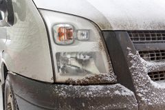 Snowy and dirty track headlight closeup. Truck in winter Stock Photos