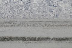 Snowy Driveway with Car Wheel Tracks. A snowy driveway photographed during winter in Finland. You can see plenty of car wheel tracks crossing each other. There royalty free stock photos