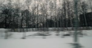 View from the train leaving Moscow. Snowy dull city scene viewing from the train running through Moscow stock video footage
