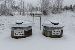 Snowy dustbins at a rest area near Filipstad Sweden. Snowy dustbins at a rest area near Filipstad in Sweden Stock Photo