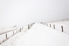 A snowy Dutch landscape with roads and fences. Royalty Free Stock Images