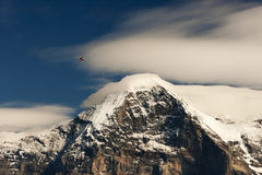 Snowy Eiger and Helicopter Royalty Free Stock Images