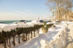 On a snowy embankment in the Bulgarian Pomorie, winter 2017 Royalty Free Stock Photo