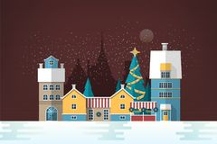 Snowy evening landscape with small European city. Cute houses and holiday street decorations. Gorgeous old town in New. Year or Christmas eve. Colorful festive Stock Photo