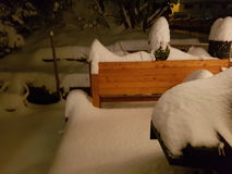 Snowy evening. Large snowfall covered deck Royalty Free Stock Image