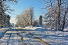 Snowy Farm Road. An old snowy farm site on a country road Royalty Free Stock Image