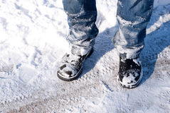 Snowy Feet. A man\'s snow covered feet and legs Stock Photo