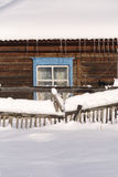 Snowy fence in the countryside. The snow sparkles in the sun. Ru Stock Image