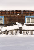Snowy fence in the countryside. The snow sparkles in the sun. Ru Stock Photo