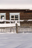 Snowy fence in the countryside. The snow sparkles in the sun. Ru Royalty Free Stock Photos