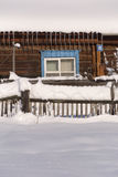 Snowy fence in the countryside. The snow sparkles in the sun. Ru Stock Photos