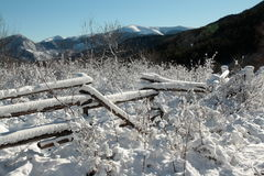 Snowy fence in Pyrenees Royalty Free Stock Photo