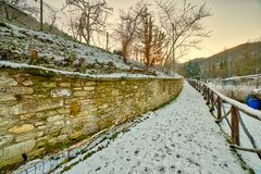Snowy footpath. Snowy fenced footpath on hills of Romagna royalty free stock photo