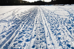 Snowy field with ski runs Royalty Free Stock Photography