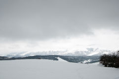 Snowy fields and mountains Royalty Free Stock Photo