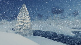 Snowy fir and frozen river at snowfall night. Winter scenery with snowy fir tree on foreground and frozen river and snowdrifts in the distance at snowfall night stock footage
