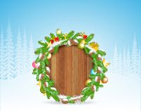 Snowy fir tree branch, cones, star and presents on round wood border. stock illustration