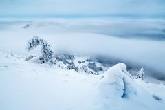 snowy and foggy mountain stock image