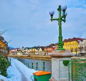 The snowy footpath along the Traun river, Bad Ischl, Salzkammergut, Austria. The narrow snowy footpath along the Oscar-Straus-Kai embankment with a view on stock images