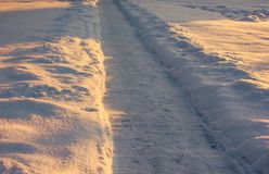 Snowy Footpath in a Countryside. With the Sun Rays Gloving over it royalty free stock photo
