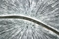 Snowy forest with a road. Aerial view. Winter Forest Aerial Stock Photography