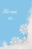 Snowy frame on blue background. Snowy frame with snowflakes on blue background with empty space for text stock images
