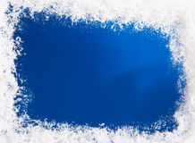 Snowy frame on blue background. Textured effect royalty free stock photography