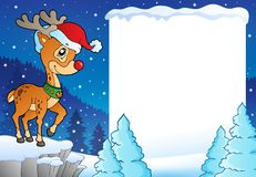 Snowy frame with Christmas reindeer Stock Photo