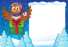 Snowy frame with owl and gift Stock Image
