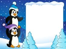 Snowy frame with penguins Royalty Free Stock Photo