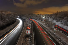 Snowy freeway. A Swiss freeway (autoroute) at night, after a fall of snow Stock Image