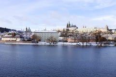 Snowy freeze Prague Lesser Town with gothic Castle above River Vltava, Czech republic Stock Photography