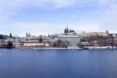 Snowy freeze Prague Lesser Town with gothic Castle above River Vltava, Czech republic Royalty Free Stock Photos