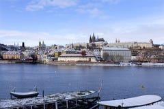Snowy freeze Prague Lesser Town with gothic Castle above River Vltava, Czech republic Stock Images