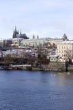 Snowy freeze Prague Lesser Town with gothic Castle above River Vltava, Czech republic Stock Photo