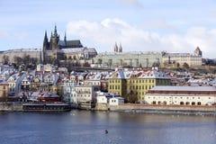 Snowy freeze Prague Lesser Town with gothic Castle above River Vltava, Czech republic Stock Image