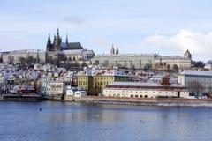 Snowy freeze Prague Lesser Town with gothic Castle above River Vltava, Czech republic Royalty Free Stock Image