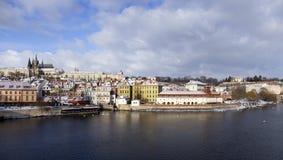 Snowy freeze Prague Lesser Town with gothic Castle above River Vltava, Czech republic Royalty Free Stock Images