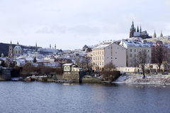 Snowy freeze Prague Lesser Town with gothic Castle above River Vltava, Czech republic Royalty Free Stock Image