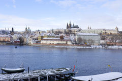 Snowy freeze Prague Lesser Town with gothic Castle above River Vltava, Czech republic Stock Photos