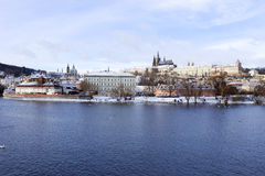 Snowy freeze Prague Lesser Town with gothic Castle above River Vltava, Czech republic Stock Images