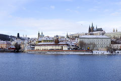 Snowy freeze Prague Lesser Town with gothic Castle above River Vltava, Czech republic Stock Image