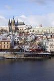 Snowy freeze Prague Lesser Town with gothic Castle above River Vltava, Czech republic Royalty Free Stock Photo