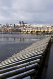 Snowy freeze Prague Lesser Town with gothic Castle and Charles Bridge, Czech republic Royalty Free Stock Photos