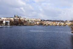 Snowy freeze Prague Lesser Town with gothic Castle and Charles Bridge, Czech republic Royalty Free Stock Photo