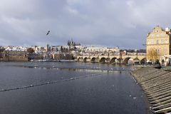 Snowy freeze Prague Lesser Town with gothic Castle and Charles Bridge, Czech republic Stock Photo