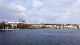 Snowy freeze Prague Lesser Town with gothic Castle and Charles Bridge, Czech republic Royalty Free Stock Image