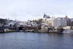 Snowy freeze Prague Lesser Town with gothic Castle, Czech republic Stock Photos