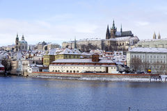 Snowy freeze Prague Lesser Town with gothic Castle, Czech republic Royalty Free Stock Photo