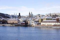 Snowy freeze Prague Lesser Town with St. Nicholas` above River Vltava, Czech republic Stock Photo